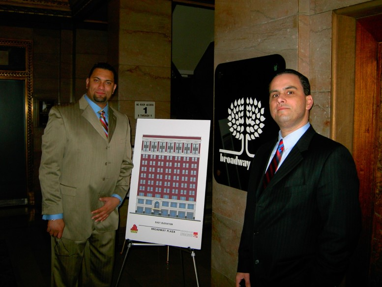 Anthony Pierpont next to an easel chart